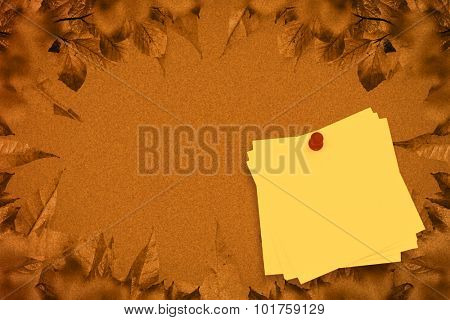Sticky note with red pushpin against autumn leaves pattern