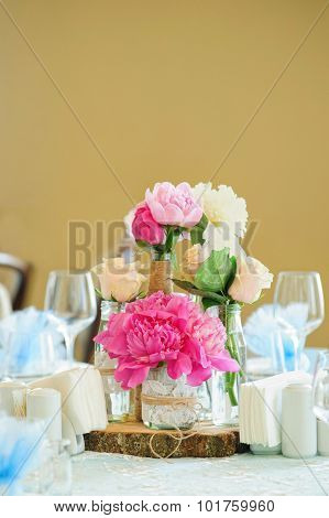 Flower composition with pink peonies and cream roses