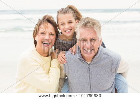 Grandparents with their granddaughter at the beach