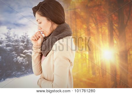 Sick brunette coughing against autumn changing to winter