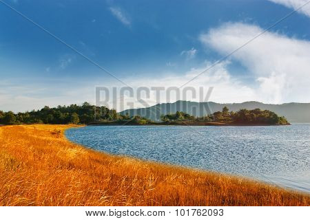 Beautiful Of Blue Sky With Yellow Grass And River