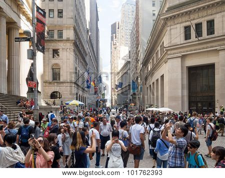 NEW YORK,USA - AUGUST 13,2015 : Tourists at Wall Street near the Federal Hall in Manhattan