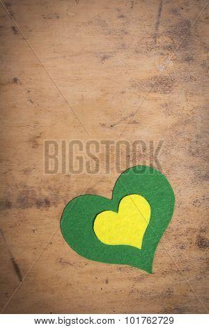felt hearts on a wooden background