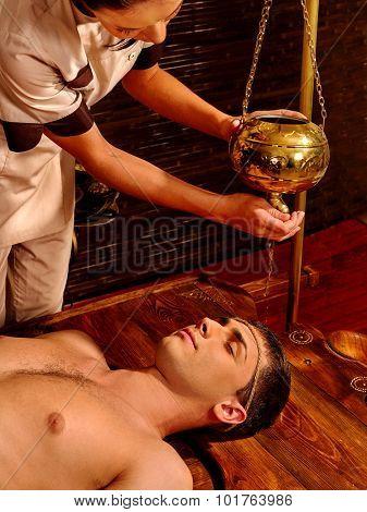 Young woman having Ayurveda spa treatment.
