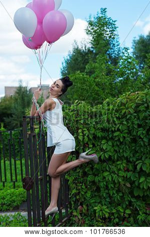 attractive woman with balloons