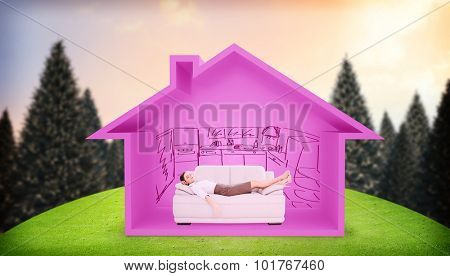 Well dressed young woman sleeping on sofa against snowy landscape with fir trees