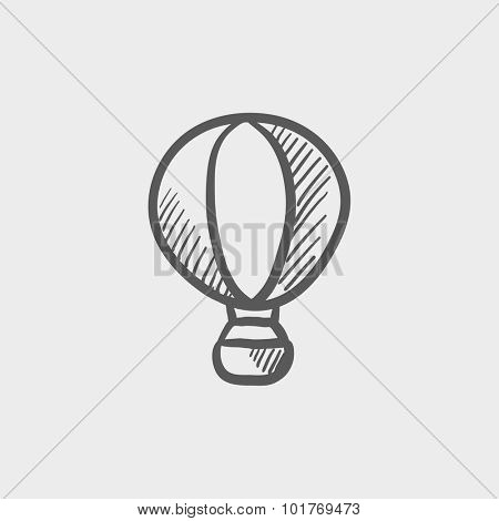 Hot air balloon sketch icon for web, mobile and infographics. Hand drawn vector dark grey icon isolated on light grey background.