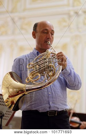 ST. PETERSBURG, RUSSIA - SEPTEMBER 7, 2015: Javier Bonet on the rehearsal with symphonic orchestra Nevsky during the International festival of French horn. The hornfest is held 3rd time