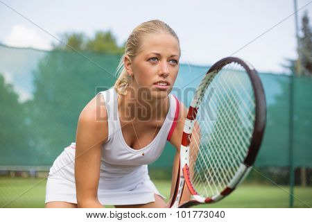 Portrait of tennis player on the court