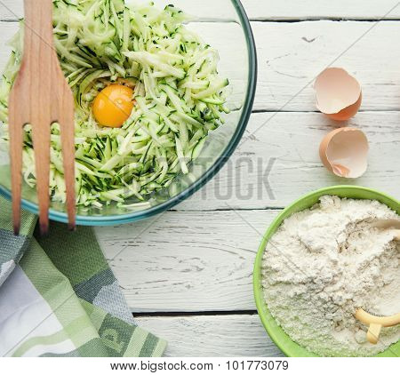 Background With Ingredients For Cooking Zucchini Pancakes