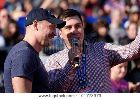 ST. PETERSBURG, RUSSIA - SEPTEMBER 12, 2015: SKA ice hockey club's coach Maksim Sokolov (left) talks with press before the exhibition match of International tennis tournament St. Petersburg Open
