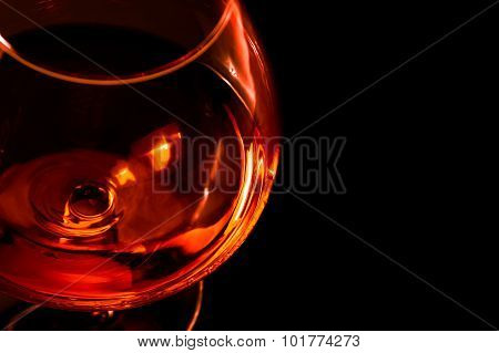 Top Of View Of Snifter Of Brandy In Elegant Typical Cognac Glass On Black Background