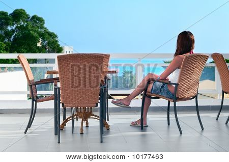 Beautiful Woman Sitting In Balcony