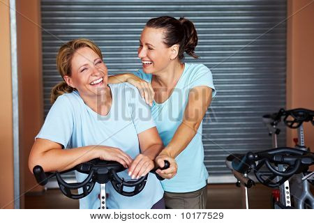 Two Happy Sorty Women In Gym