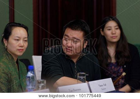 ST. PETERSBURG, RUSSIA - SEPTEMBER 14, 2015: Producer Zhang Lei during the press conference with women's chamber orchestra