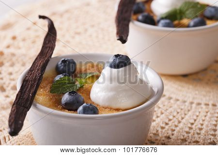 Vanilla Creme Brulee Dessert With Blueberries Close-up. Horizontal