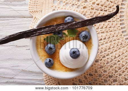 Creme Brulee With Blueberries Closeup. Horizontal Top View