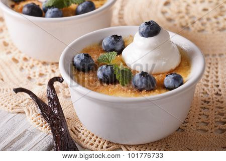 Creme Brulee Decorated With Blueberry Close-up. Horizontal