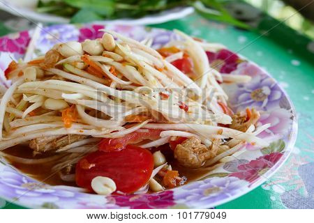Spicy Papaya Salad On Colorful Plate