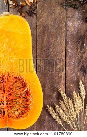 Halved pumpkin on wooden background