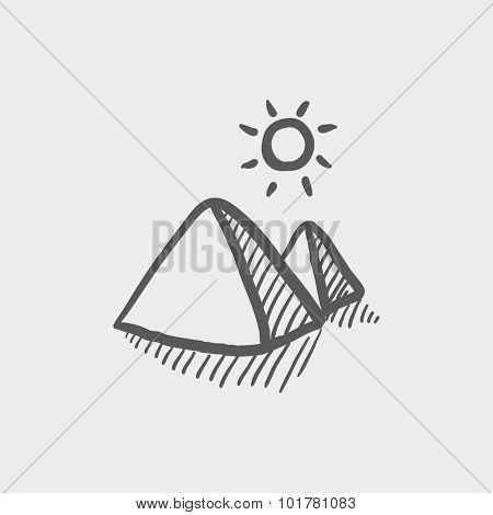 Egyptian pyramids sketch icon for web, mobile and infographics. Hand drawn vector dark grey icon isolated on light grey background.