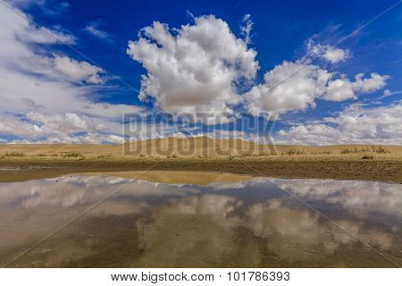 Gobi Desert After Rain. Reflection Of Clouds In Pools.