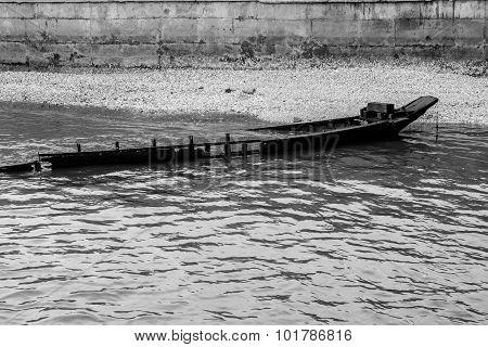 Black And White Of Destroyed Vintage Wooden Boat.