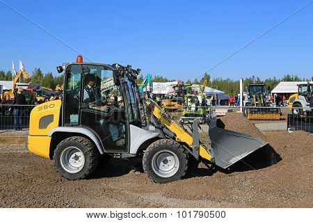 Kramer Allrad 350 Wheel Loader Moves Gravel