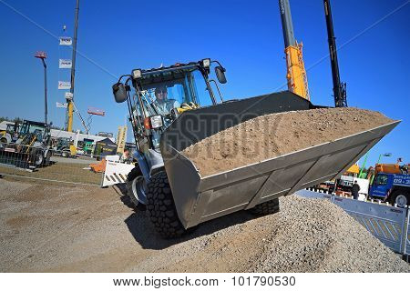 Man Works With Kramer Allrad 350 Wheel Loader