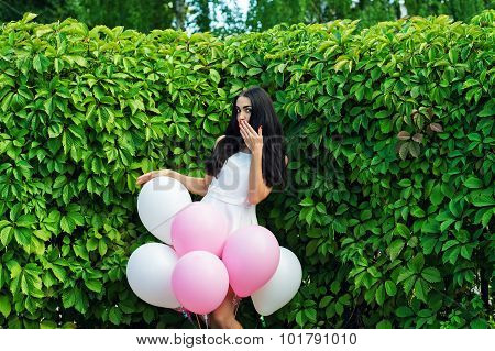 attractive woman with balloons flirting