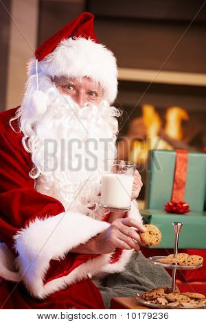 Santa Claus With Milk And Chocolate Chip Cookies