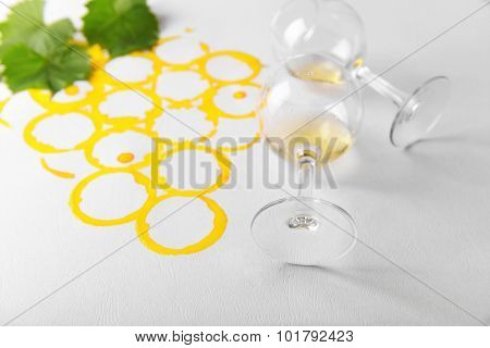 Wine glasses on picture painted with wine