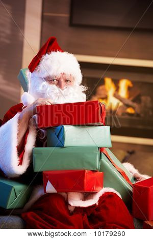 Portrait Of Santa With Pile Of Christmas Presents