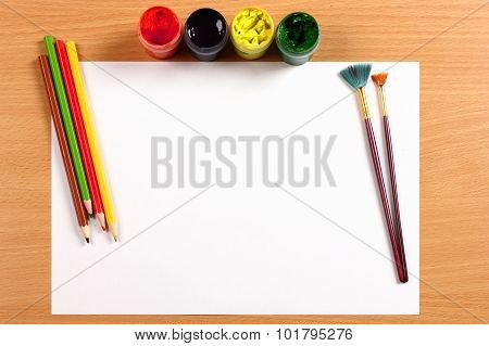 Empty Sheet With Paint And Pencils On Desk, Creativity Concept