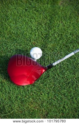 Golf Driver Hitting Golf Ball on Golf Tee