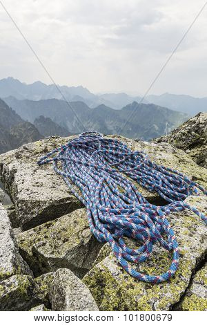 Rope Is Located On Boulders On A Mountain Top