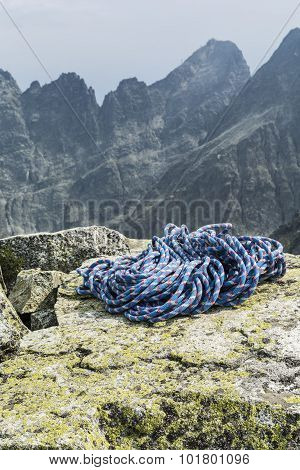 Rope On The Rocks With Peaks In The Background