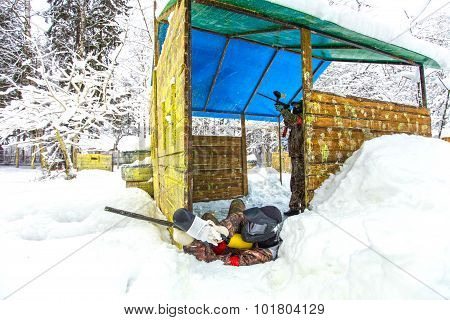 Two Friends Playing Paintball In Winter Snowdrift