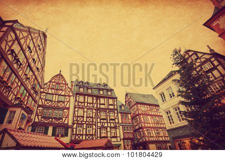 Christmas Eve in Bernkastel-Kues, Germany. Photo in retro style. Added paper texture. Toned image