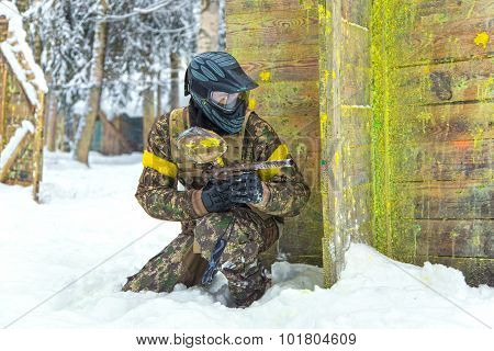 Experienced Sportsman In Professional Paintball Armor On Winter Training Outdoors