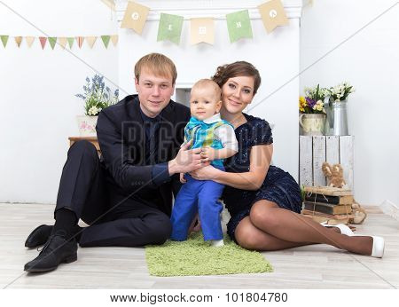 Father, Mother And One Year Old Toddler Boy At Home