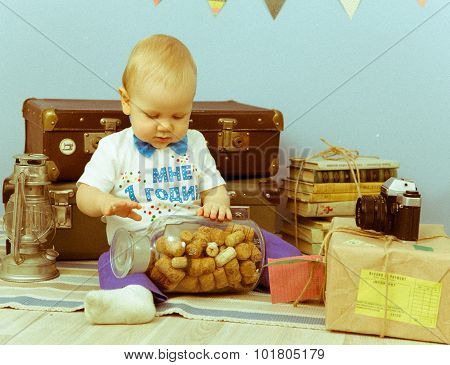 Vintage Portrait Of Little Child Playing With A Bottle Filled With Corks
