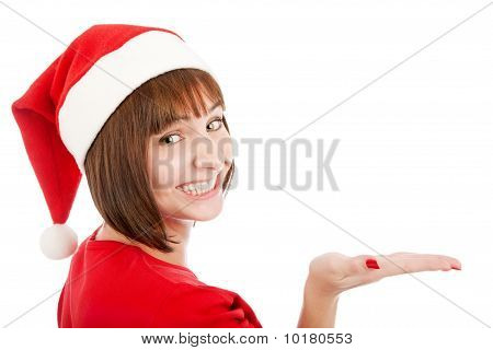 Smiling Woman In Santa Hat Presenting Your Product