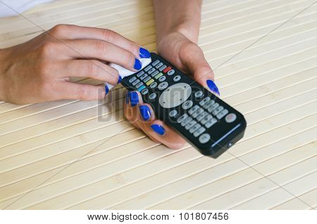 Female Hands Wipe Dust Remote Control