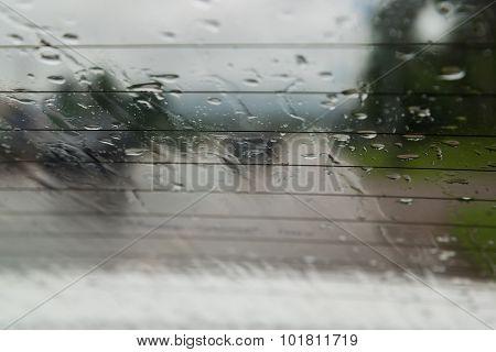 Soft shot of Drops Of Rain On car Glass Background.
