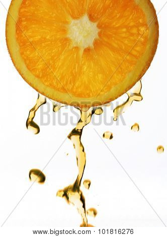 Orange juice droping from orange slice