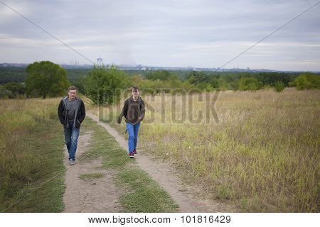 Girl Walking With A Friend In Nature.