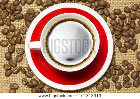 Cup Of Coffee And Coffee Beans On Sackcloth