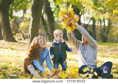Happy Family Having Fun In Autumn Urban Park