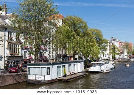 Canal With Houseboats In Amsterdam, The Netherlands